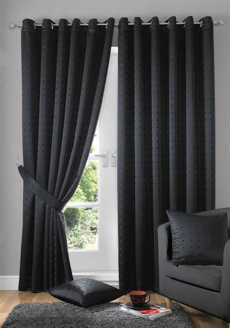 room with black curtains black curtain with black pillow on black sofa in living