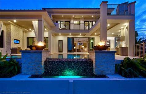 Luxury Modern House Front Modern fourplans totally modern luxury homes builder magazine
