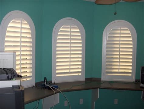 l shades port fl norman shutters with arches serving palm