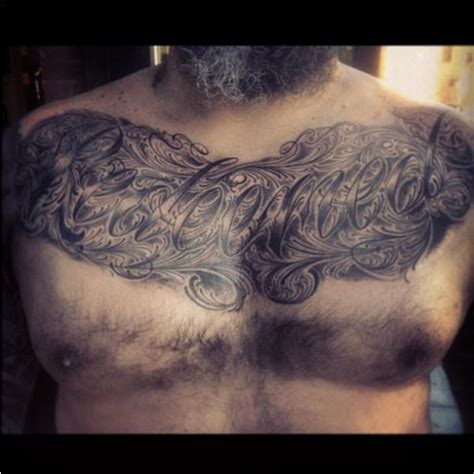 side chest tattoo chest lettering tattoos
