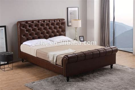 faux leather upholstered sleigh bed nailhead studded