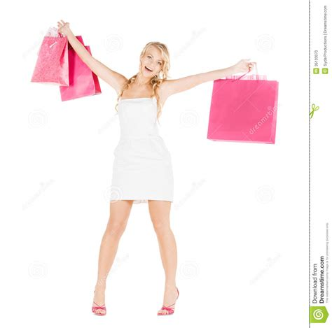 high heel shopping with shopping bags in dress and high heels stock