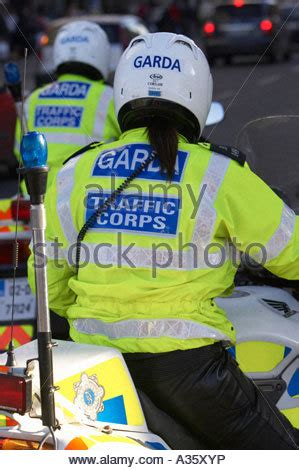 female police officer on a mobile telephone uk stock photo