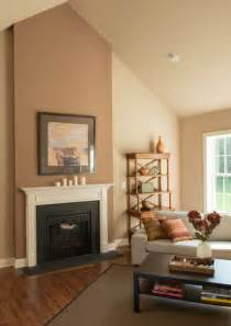 fireplace as the focal point in this great room a cathedral ceiling hardwood flooring and an