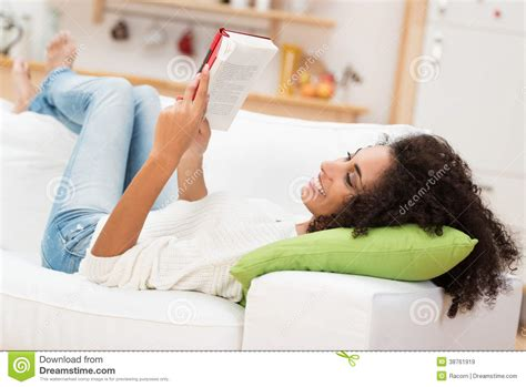 Beautiful Young Woman Reading A Book Royalty Free Stock
