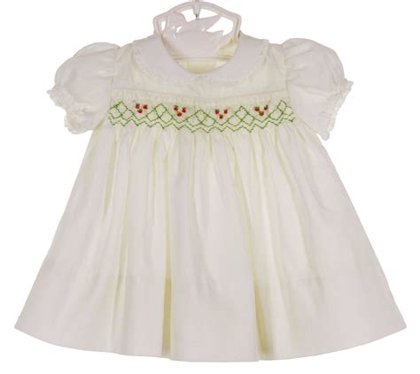 Polly flinders white smocked christmas dress for baby girls polly flinders white smocked