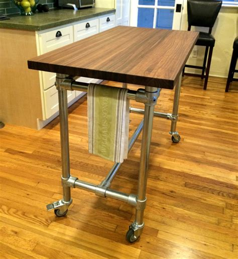 rolling kitchen island kitchen island table design your butcher block rolling kitchen island helps you entertain