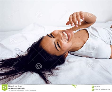 pretty in bed pretty in bed smiling royalty free stock images image 32516419