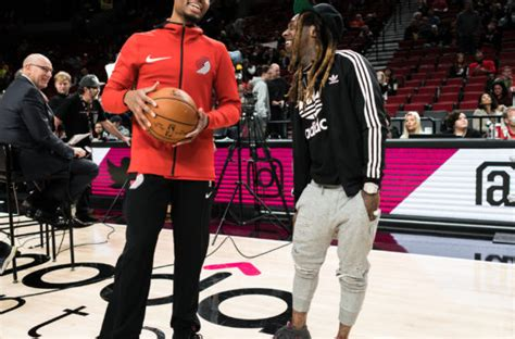 Dame 4 Glow In The lil wayne sitting courtside while wearing adidas dame 4