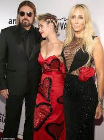 miley cyrus mother tish wows in mesh top at amfar gala