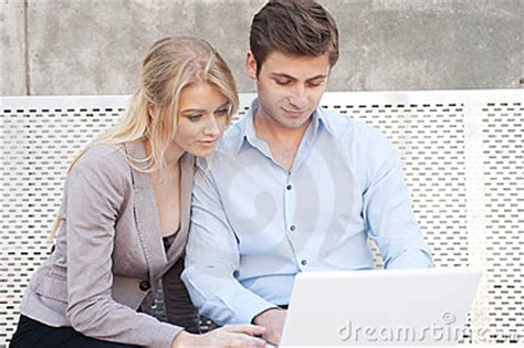professional couple young professional couple on laptop royalty free stock