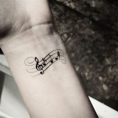 small music tattoos for men 15 small note tattoos cross design