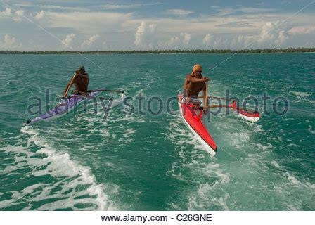 canoe boat wake outrigger canoe on lagoon island of huahine french