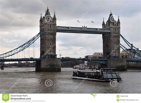boat going under tower bridge tower bridge and touristic boat in london editorial photo
