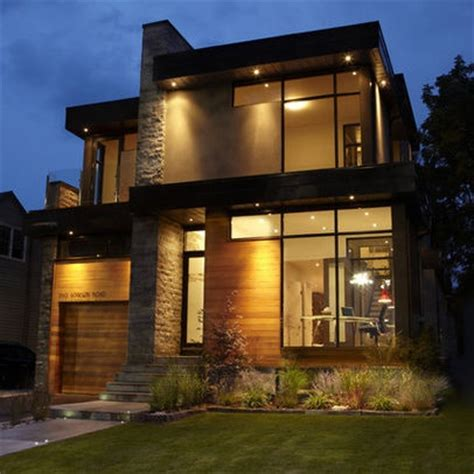 modern brick house plain walls monolithic stone walls large curtain wall