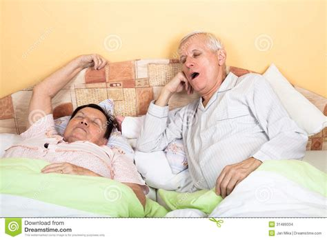 how to be good in bed for men sleepy senior couple yawning in bed stock images image