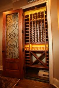 Outdoor Space Dividers - closet converted to wine cellar traditional wine cellar atlanta by cellars south