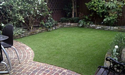 artificial grass lawn garden london with brick patio