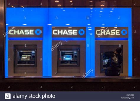 jp new york customer uses the atm machines at a jpmorgan bank in