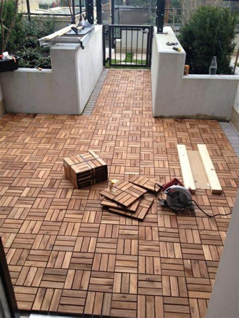 klick holzfliesen verlegen holzfliesen verlegen holzboden auf dem balkon