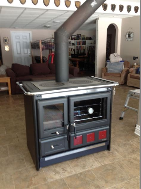 la nordica thermo suprema kitchen with wood burner enchanting home design