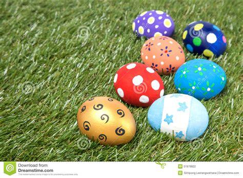 Handmade Easter Eggs - colorful handmade easter eggs on green grass stock photo