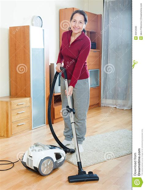 Vacuum Cleaner Happy King vacuuming at house vector illustration