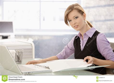 Office Worker At Desk Office Worker Doing Paperwork At Desk Royalty Free Stock Photo Image 24588175