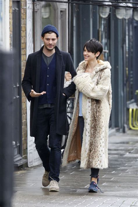 Jamie Dornan's wife Amelia Warner is all smiles amid rumours her husband will quit Fifty Shades