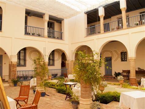 inner garden patio of historic house in cordoba stock