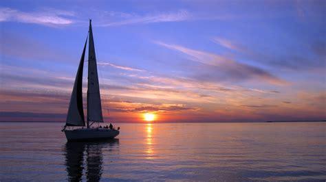 sailing boat in the sea boats silboat boats ship sailing ocean sea sky clouds