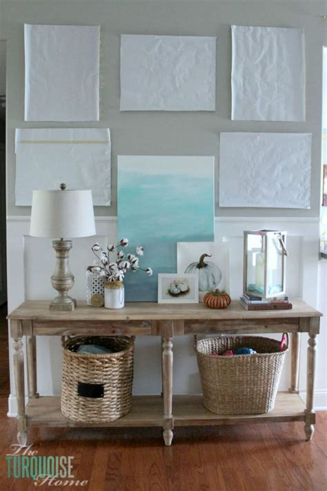 how to decorate a sofa table console table update decor and frame placement