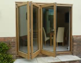 Folding Doors by Home Entrance Door Folding Patio Doors
