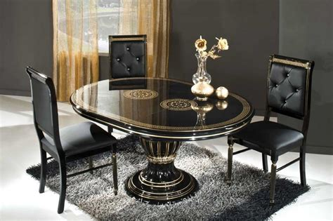 Black Oval Dining Room Table Small Black Rug Oval Glass Top Dining Table Combined With Black Leather Arm Less Chairs In