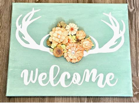 painting on canvas welcome to docblogs diy welcome sign deer antlers paper flowers little birdie