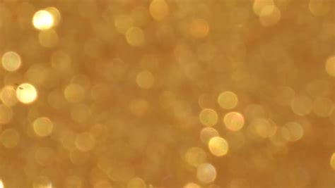 Paket Gold Glowing 1 moving golden glitter lights stock footage 18656309