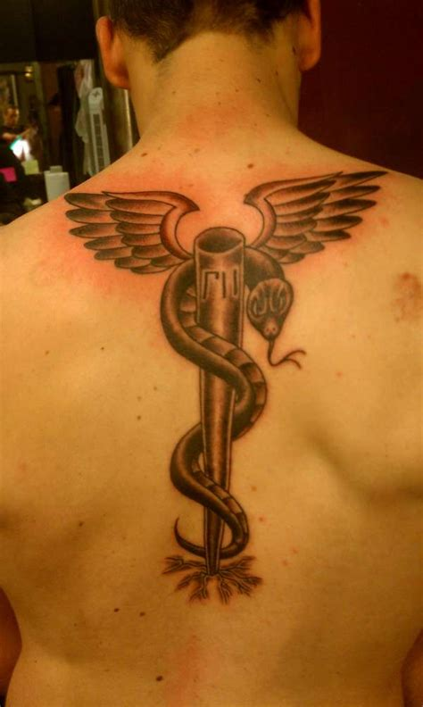 rod of asclepius tattoo caduceus asclepius