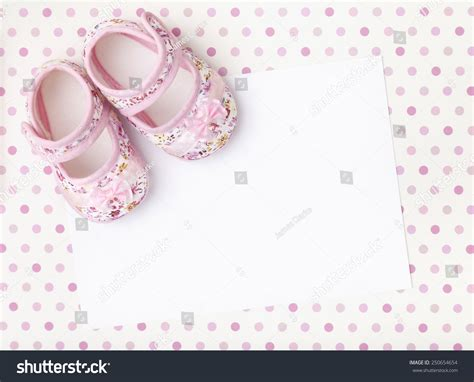 background birthday theme for babies blank card with baby shoes on a pastel pink spotted