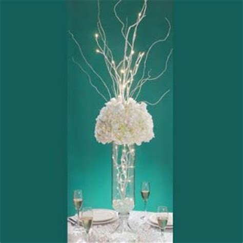 light up twig branches stand centerpiece light up twigs with flowers david tutera
