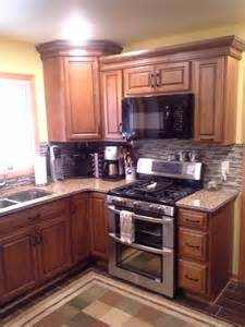 Remodeled diamond reflection whiskey black cabinets granite counter