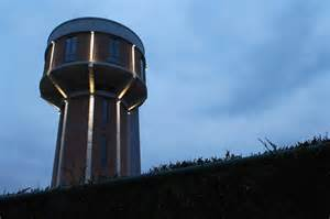 water tanks new lives as a house and a cafe the