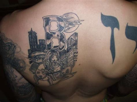 boston skyline and hebrew lettering tattoo
