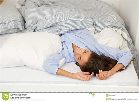 sleeping in comfortable bed stock photo