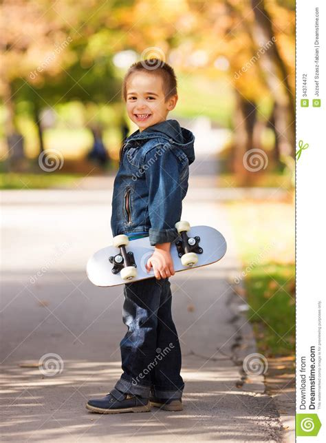 who is the little kid in the new geico commercial little kid holding skateboard stock photo image 34374472