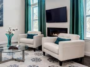 White contemporary living room with turquoise curtains bright