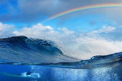 sea water underwater waves split view rainbows