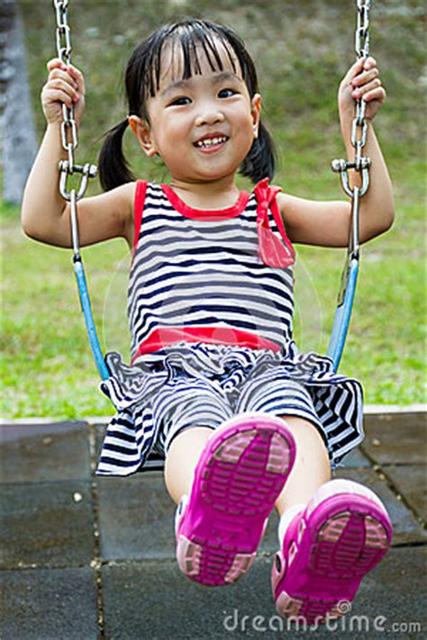 Asian Kid Swing At Park Stock Photo Image 57107925