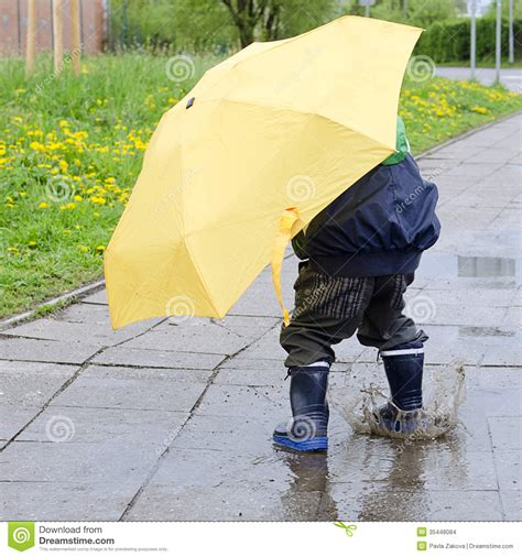 X2 3746 St Umbrella child with umbrella in puddle stock photo image 35448084