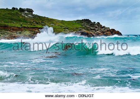 rough seas on the isles of scilly stock photo, royalty
