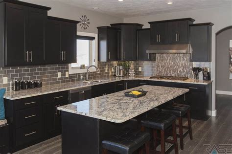 contemporary kitchen with stone tile glass panel in contemporary kitchen with raised panel hardwood floors